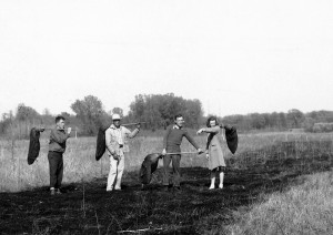 Pepper Jackson, Aldo Leopold, Jim Hale, and Mary Ellen Helgren on a controlled prairie burn at the Arboretum, ca. 1945. Photo: Aldo Leopold Foundation/UW–Madison Archives