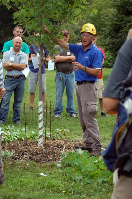 Mike Wendt demonstrates pruning. Photo: Bill Reichenbach
