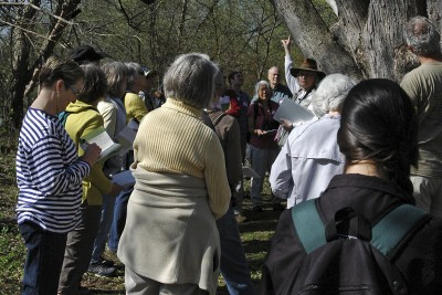 Arboretum naturalist Kathy Miner leads a tour as part of volunteer steward training, which takes to the field every spring. The prospective stewards are at the Arboretum's Wingra Oak Savanna, where Kathy weaves natural history, historical stories, and poetry into her tour.
