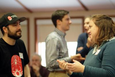 Scott Larson (left), Laura Ladwig (right), Jordan Mandli (background, center)