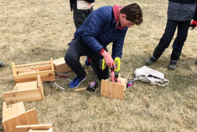 Owen Brown finishing bluebird boxes before installation