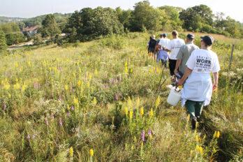 Volunteer group on trail at hillside prairie Pasque Flower hill