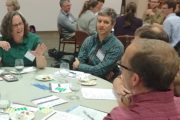 Groups of educators and researchers brainstorm how they might work together.