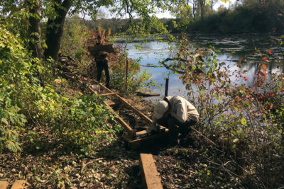 Student rangers installing a section of boardwalk.