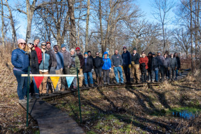 Arboretum staff gathered to celebrate the reopening of Ho-Nee-Um Pond boardwalk.