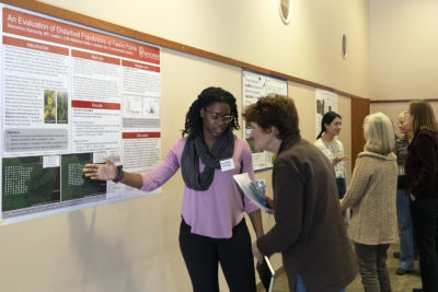 Mercedez Kennedy and Jade Kochanski present posters at the Arboretum Research Symposium.