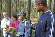 Marian instructs volunteers on identifying invasive species.