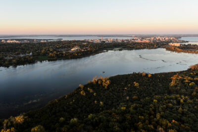 The Arboretum and Lake Wingra make up the foreground of this image featuring the UW–Madison campus and the Isthmus.