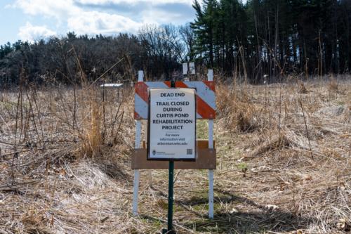 Trail closure signs in Curtis Prairie